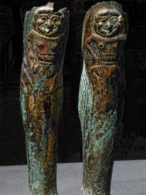 Bronze Greaves with Bone Inlay engraved with images of a G